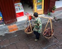 A man selling dried meat at Fenghuang Ancient Town in Hunan, China Stock Photography