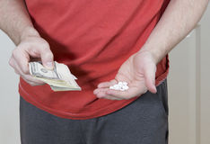 Man is selling drugs. Stock Image
