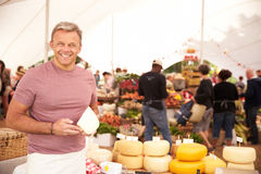 Man Selling Fresh Cheese At Farmers Food Market Royalty Free Stock Photography