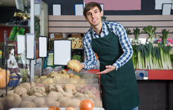 Man selling fresh vegetables and herbs Stock Photo