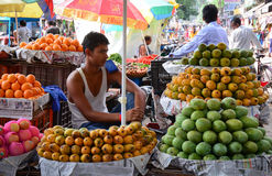 A man selling fruits at local market in Delhi, India Royalty Free Stock Image
