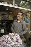 The man selling garlic royalty free stock images