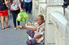 Man selling homemade toys. ( wicker trosnik of elephants ) on the bridge near Bangkok's Pratunam Thailand Stock Images