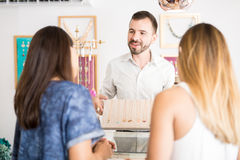 Man selling jewelry at a store Stock Image