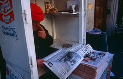 A man selling newspapers, London. Royalty Free Stock Photography