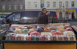 Man is selling nuts and dried fruits Stock Photo
