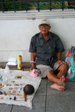 Man selling objects, Thailand. Royalty Free Stock Images