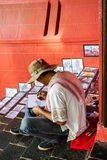 A man selling paints at Dutch Square in Malacca City, Malaysia Stock Photo