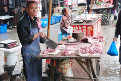 Man selling pork Stock Photos