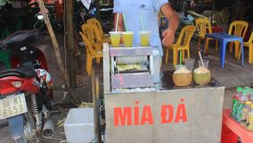 Man selling pressed sugarcane juice in the market