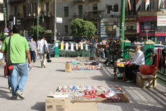 A man selling revolution souvenirs in cairo egypt. A man selling revolution souvenirs and flags in cairo egypt, People in tahrir square, selling Egyptian flags Royalty Free Stock Images
