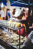 Man selling snack at the market royalty free stock image