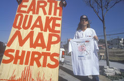 Man selling t-shirts with a map of the quake Royalty Free Stock Photos