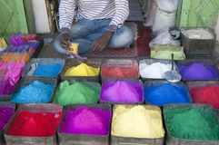 Man Selling Colours. A man selling various colours on the street, outdoor cropped shot Royalty Free Stock Image