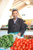 Man selling vegetables in the market stock photos