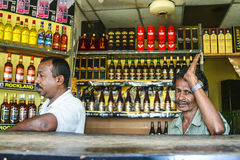 Man sells alcohol in a licenced alcohol shop in Negombo Stock Images