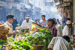 Man sells bananas at the old. DELHI, INDIA - OCT 16: Chawri Bazar is a specialized wholesale market of food and vegetables on Oct 16, 2012 in Delhi, India Royalty Free Stock Images