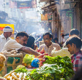 Man sells bananas at the old. DELHI, INDIA - OCT 16: Chawri Bazar is a specialized wholesale market of food and vegetables on Oct 16, 2012 in Delhi, India Stock Photos