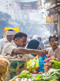Man sells bananas at the old. DELHI, INDIA - OCT 16: Chawri Bazar is a specialized wholesale market of food and vegetables on Oct 16, 2012 in Delhi, India Stock Image