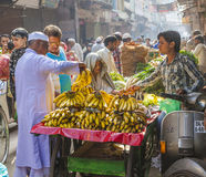 Man sells bananas at the old Stock Photo