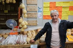 Man Sells Cheese And Salami Royalty Free Stock Image