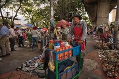 Free Man Sells Coffee In The Flea Market In Medellin, Colombia Stock Photos - 139328533