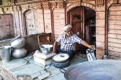 Man sells curd in the front of a Haveli in Bikaner Royalty Free Stock Image