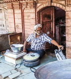 Man sells curd in the front of a Haveli in Bikaner Stock Image