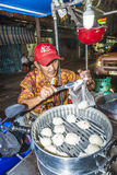 Man sells delicious dumplings at the outdoor market Stock Image