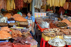Man sells dry fishes Stock Images