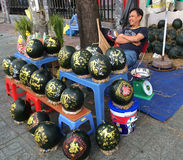Man sells engraved water melons for Tet (Lunar New Year in Vietn Royalty Free Stock Image