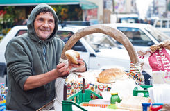 Man sells Frittola. PALERMO - DECEMBER 29: Man sells Frittola on the local market in Palermo, called Ballaro. This market is also tourist attraction in Palermo Royalty Free Stock Photography