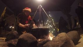 Man sells hot mulled wine stock video