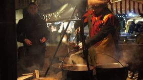 Man sells hot mulled wine stock footage