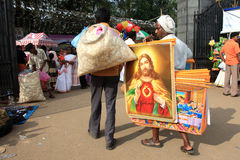 A man sells the images of Jesus Christ Stock Photo