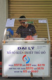 Man sells lottery tickets on street in Hanoi Royalty Free Stock Photography