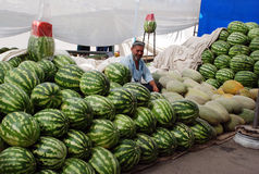 A man sells melons and watermelons Stock Photography