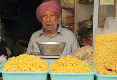 Man sells something in the market of Delhi, India Royalty Free Stock Photography
