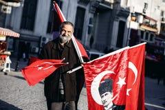 Man sells turkish flags Stock Photos