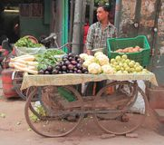 Man sells vegetables in the market of Delhi, India Stock Image