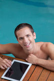 Man sending a message in the edge of the pool Royalty Free Stock Image