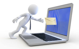 Man sending a message through the screen of a lapt Stock Images