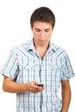 Man sending messages on phone mobile. Young man using his phone mobile to send a message isolated on white background,check also Business people Stock Photos
