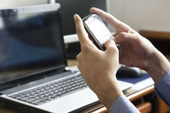 man sending or receiving an sms Stock Image