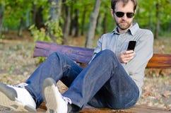 Man sending sms Stock Photography