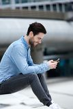 Man sending text message on cellphone Royalty Free Stock Photo