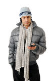 Man sending text in winter clothes Stock Photography