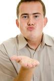 A man sends a air kiss. Royalty Free Stock Image