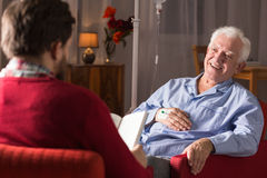 Man with senile dementia. Carer assisting senior men with senile dementia royalty free stock photography