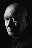 Man senior. On black background looking at camera, monochrome Stock Image
